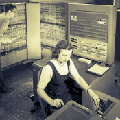Man and woman shown working with IBM type 704 electronic data processing machine used for making computations for aeronautical research. Photo: IBM